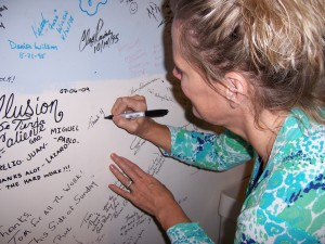 Carlene Crom signs wall of fame upon completely her CD recording.