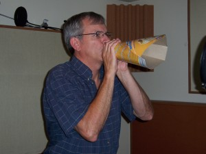 Corporate voice-over bullhorn recording.