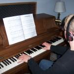 Calvin plays piano at Tesco Productions
