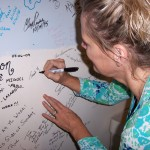 Carlene signs the Tesco Productions wall of fame