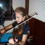 Maria plays fiddle at Tesco Productions