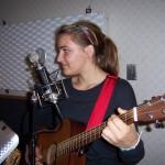 Sarah plays guitar at Tesco Productions