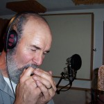 Phil Kleymann croons on the harmonica for Justin Michael.