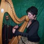 Grace rehearsing large harp.
