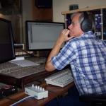 Tom Sharman watches Alexa's recording process.