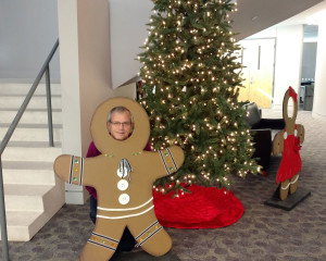 Tom Sharman behind gingerbread man at CIOH event.